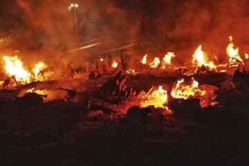 Numerous dead bodies being burnt as far as you can see in Delhi's old Seemapuri Cremation Center